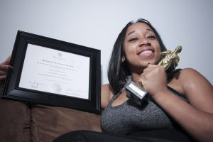 Here's Abigail proudly showing off her college diploma and a trophy she created for herself. It's a reminder to always stay motivated – and (we think) a well-deserved token of her achievements!